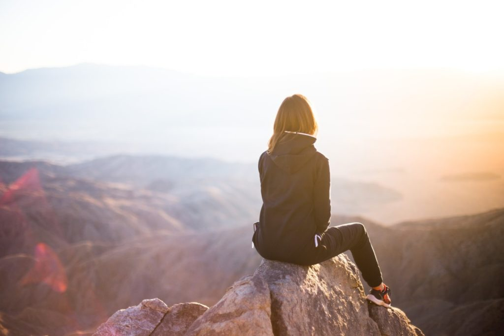 a young person daydreaming over a beautiful landscape